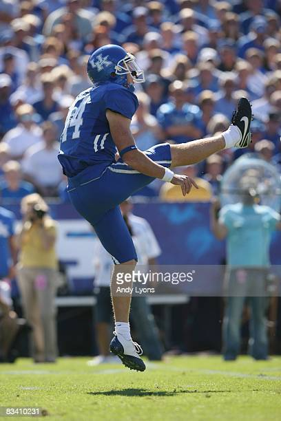 Punter Tim Masthay of the Kentucky Wildcats follows through on a kick against the South Carolina Gamecocks during the game at Commonwealth Stadium on...