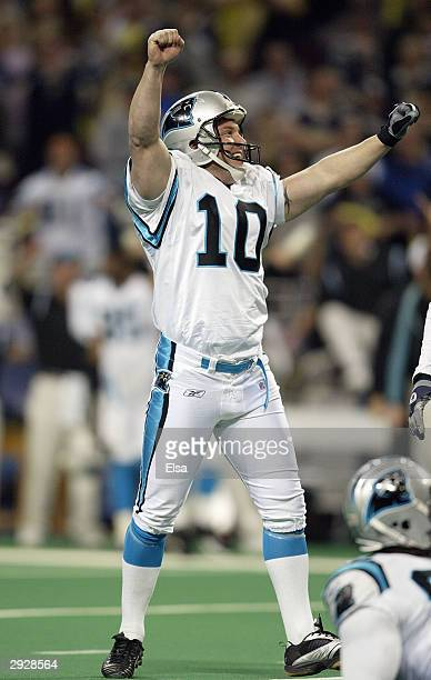 Punter Todd Sauerbrun of the Carolina Panthers celebrates on the field during the NFC Divisional Playoff game against the St. Louis Rams on January...
