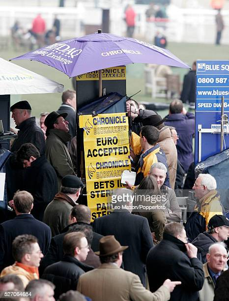 Punters and racegoers place bets with the oncourse bookmakers during racing at the 2006 Cheltenham Festival at Cheltenham Racecourse on 15th March...