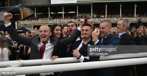 Punters celebrate their horse winning in Race Five of the Everest 2017 horse race meeting the world richest turf race at Royal Randwick race course...