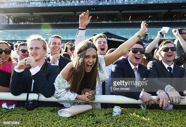 Punters display their jubilation at the result of Race 7 at The Star Epsom Day at Royal Randwick Racecourse on October 4 2014 in Sydney Australia