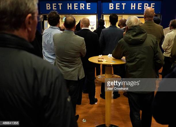 Punters in the betting shop at Sandown racecourse on April 25 2014 in Esher England