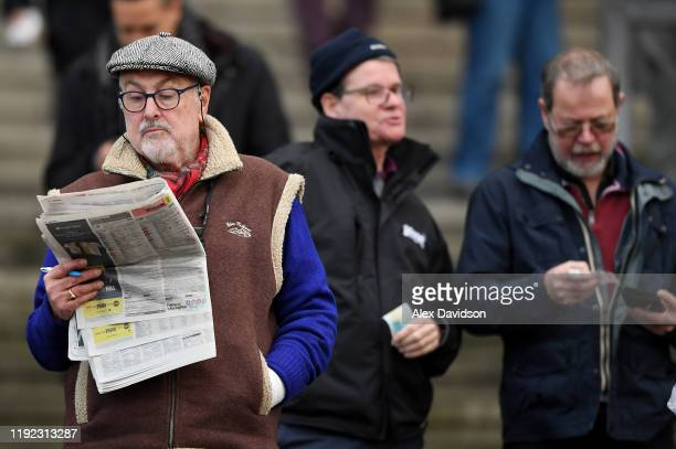 Punters look on during a meeting at Sandown Park on December 06 2019 in Esher England