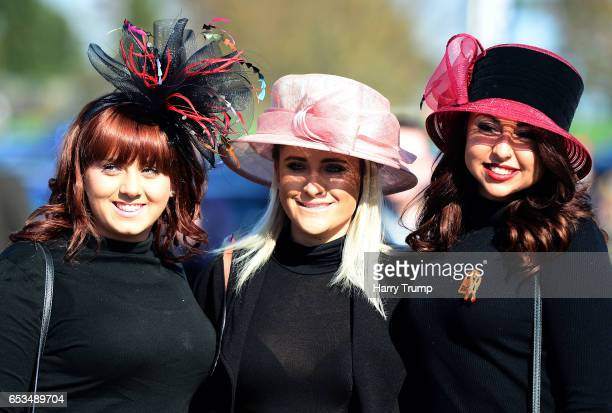 Punters pose prior to entering the racecourse during Ladies Day of the Cheltenham Festival at Cheltenham Racecourse on March 15 2017 in Cheltenham...