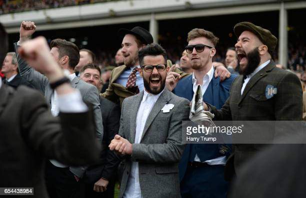 Punters react during the JCB Triumph Hurdle Race during Gold Cup Day of the Cheltenham Festival at Cheltenham Racecourse on March 17 2017 in...