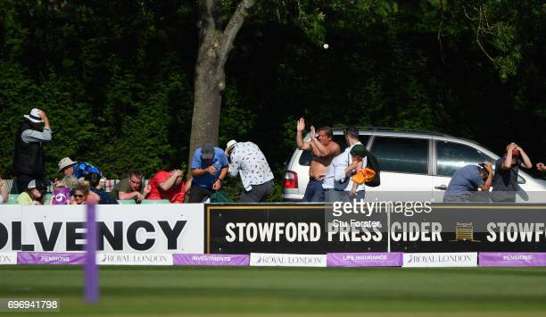 Punters take action to avoid a six hit from Ross Whiteley during the Royal London OneDay Cup Semi Final between Worcestershire and Surrey at New Road...