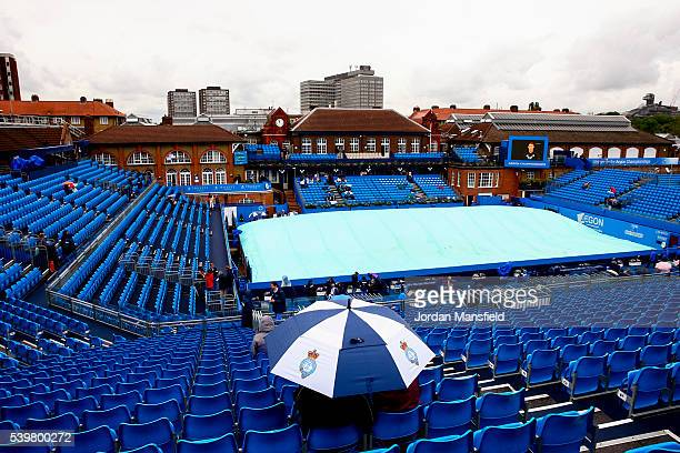 Punters watch on as rain delays the start of play during day one of the Aegon Championships at the Queens Club on June 13 2016 in London England
