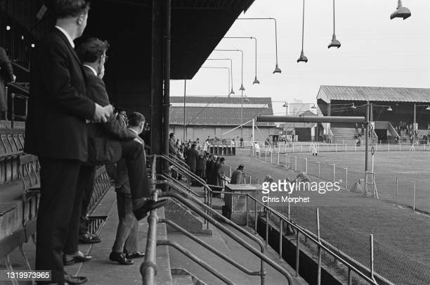Punters watching greyhounds racing on 1st straight from the main stands at Park Royal Greyhound Stadium, London, UK, circa 1968.