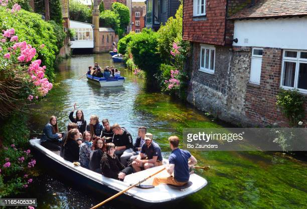 punting on river stour in central canterbury in kent, england. - bo zaunders stock pictures, royalty-free photos & images