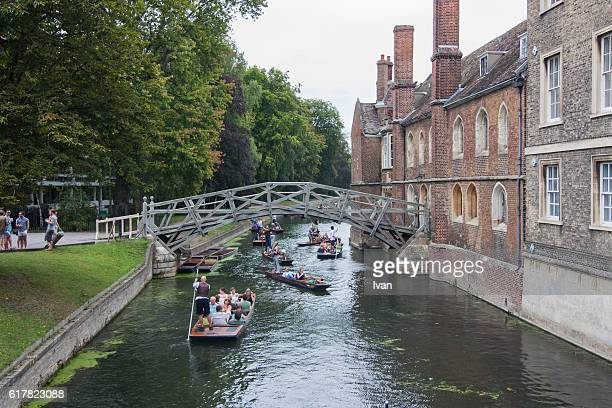 Punting on the river Cam with Mathematical Bridge, Cambridge, England, UK