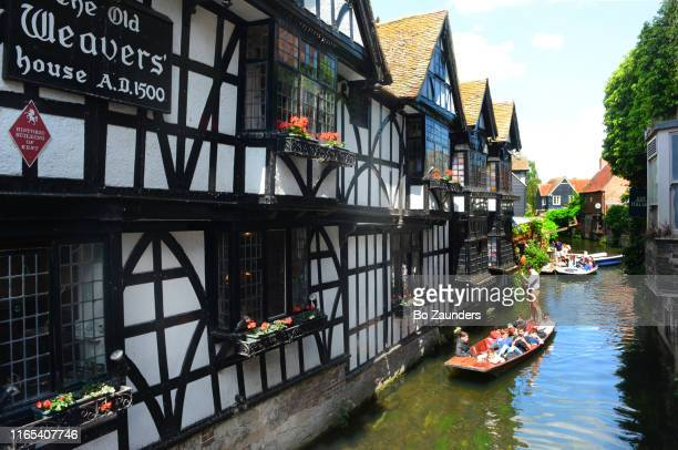 punting on the stour river, next to the half-timbered old weavers house, in canterbury, uk - bo zaunders stock pictures, royalty-free photos & images