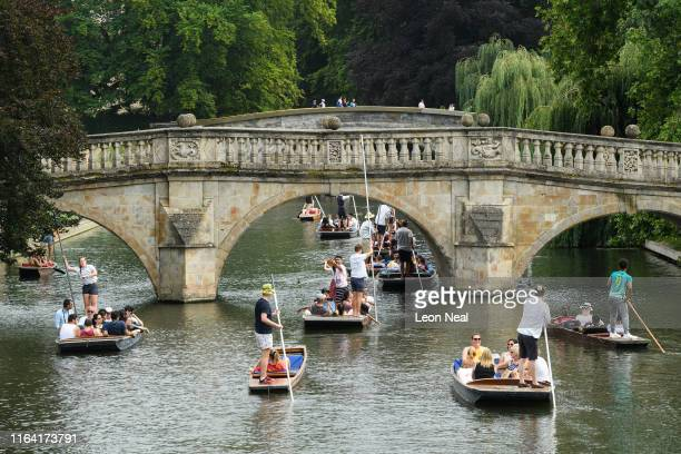 Punts are piloted up and down the River Cam on July 25 2019 in Cambridge United Kingdom The Met Office issued a weather warning from 3pm this...