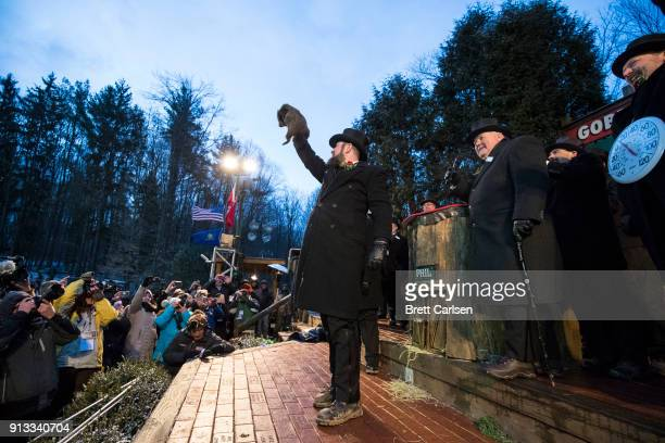 Punxsutawney Phil is held up by his handler for the crowd to see during the ceremonies for Groundhog day on February 2 2018 in Punxsutawney...