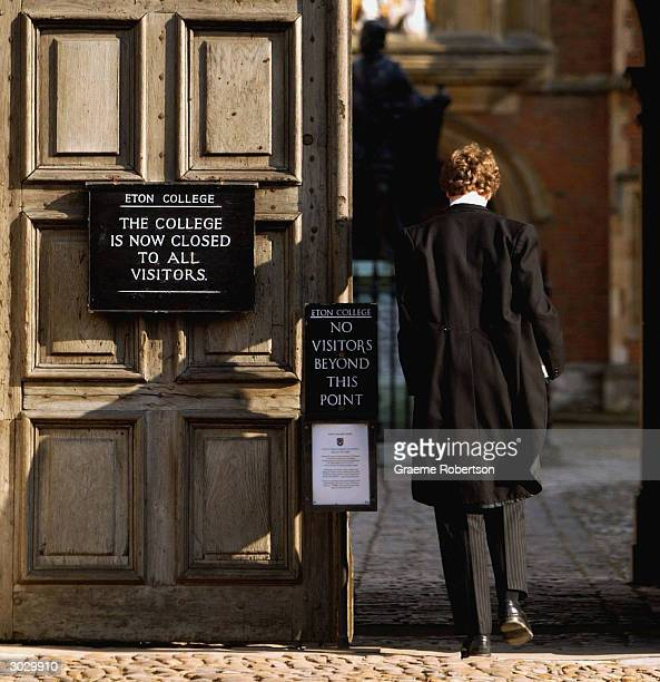 Pupil at Eton College hurries between lessons March 1 2004 wearing the school uniform of tailcoats and starched collars in Eton England Dozens of the...
