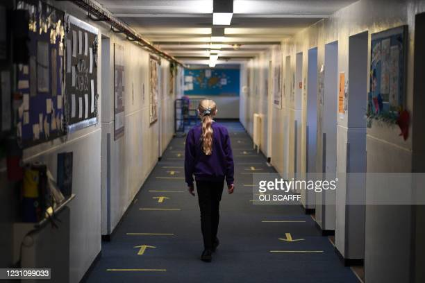 Pupil at Outwood Primary Academy Park Hill walks down a corridoor in Wakefield, northern England on February 11, 2021.