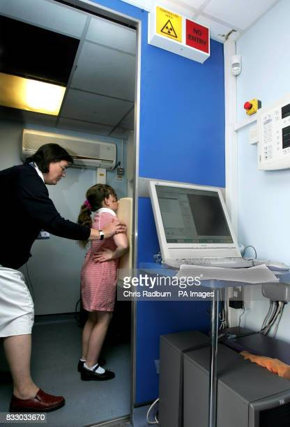 A pupil from Southfield Junior School in Luton Bedfordshire prepares for a chest Xray after several pupils from the same class tested positive for TB