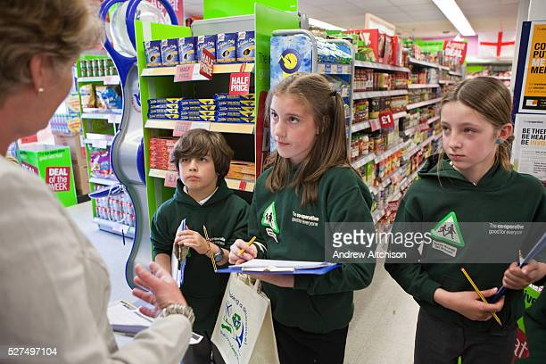 Pupil from the St. Columb Minor school in Cornwall, completes a community energy survey by talking to customers in the local Co-Operative...