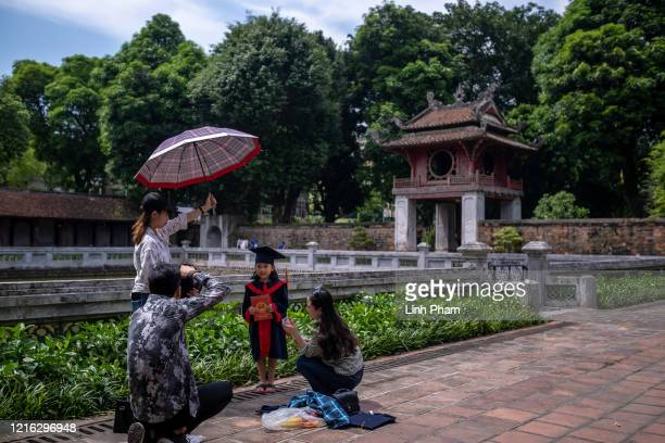A pupil has her kindergarten graduation photo taken at Temple of Literature a popular destination amongst both locals and tourists on May 31 2020 in...
