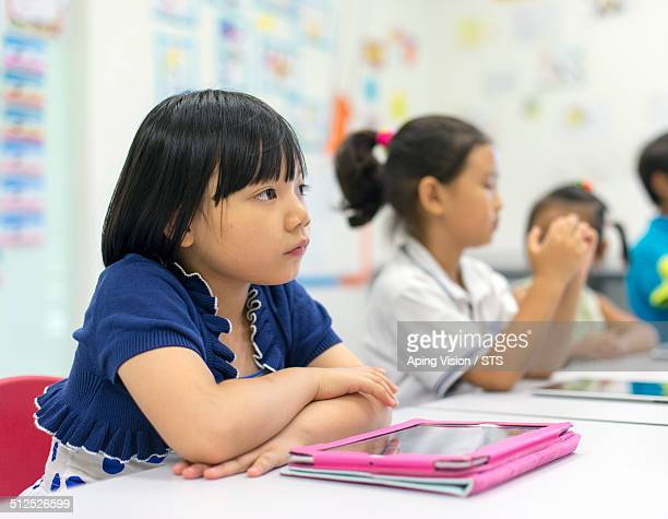 pupil in class with digital tablet
