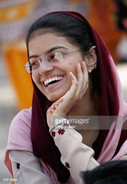 Pupil laughs as she relaxs at Fatima Jinnah Womens University on the third day of the Royal Tour of Pakistan on October 31 2006 in Islamabad Pakistan...
