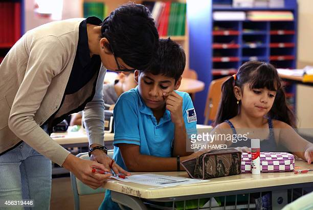 A pupil listens to his teacher at the international French School MLF 'Danielle Mitterrand' on September 28 2014 in Arbil the capital of the...