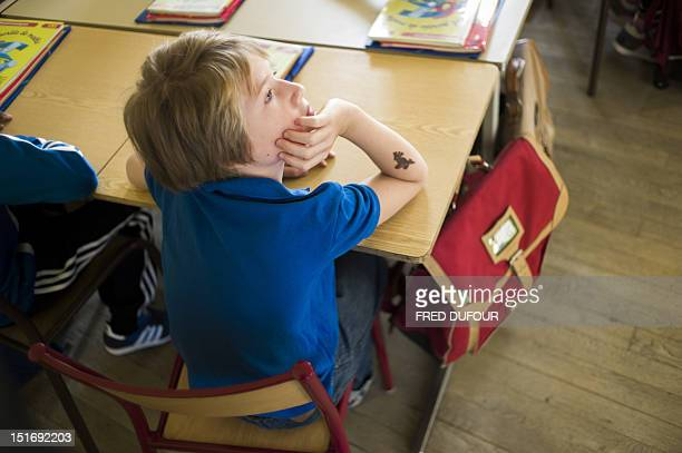 A pupil listens to the teacher in a classroom at an elementary school on September 4 2012 in Paris after the start of the new school year AFP PHOTO /...