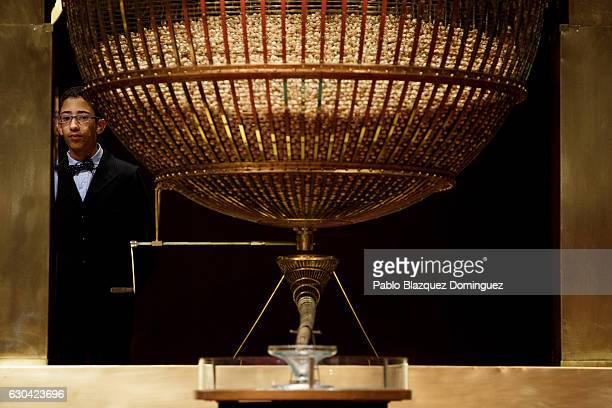 A pupil of the San Ildefonso school stands behind a drum during the draw of Spain's Christmas lottery named 'El Gordo' at the Teatro Real on December...