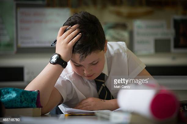 A pupil reads during a english lesson at the Ridings Federation Winterbourne International Academy in Winterbourne near Bristol on February 26 2015...