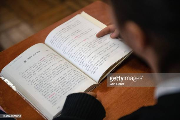 A pupil reads from a Koreanlanguage textbook during a lesson at Tokyo Korean Junior and Senior High School on January 22 2019 in Tokyo Japan The...