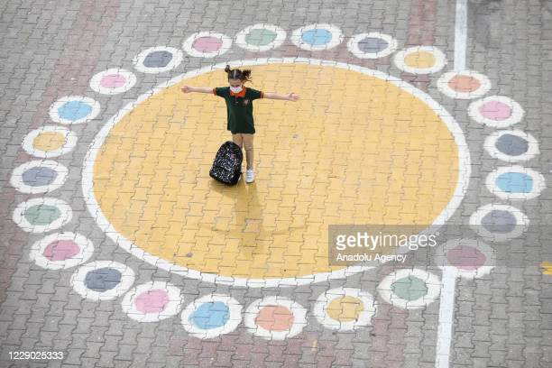 Pupil standing in the middle of a social distancing circle prior to her lesson in the class after second phase of in-person lessons began, in...