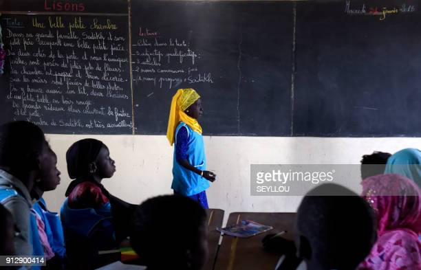 TOPSHOT A pupil stands in front of her class at a pilot school of the Global Partnership for Education in Tivaouane near Dakar on January 31 2018...