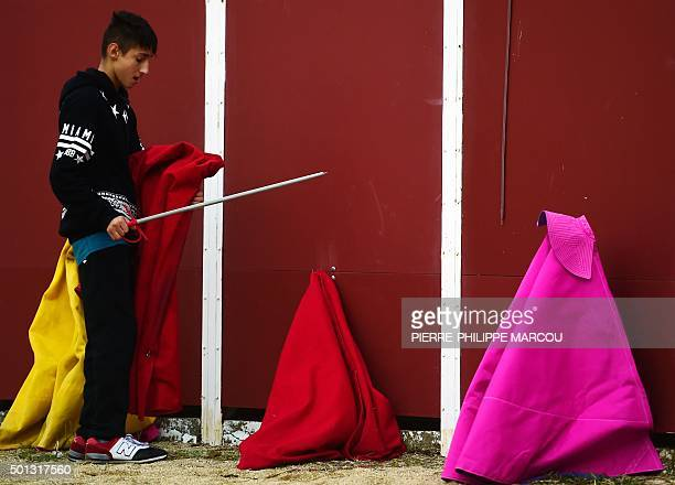 A pupil stands next to 'muletas' and a 'capote' during an open air class at Marcial Lalanda bullfighting academy in Madrid's Casa de Campo park on...