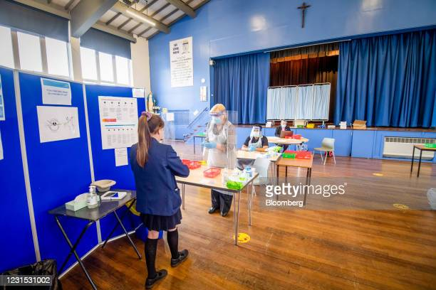Pupil takes a Covid-19 test in the school hall at All Saints Catholic College in Dukinfield, Great Manchester, U.K., on Friday, March 5, 2021. On...
