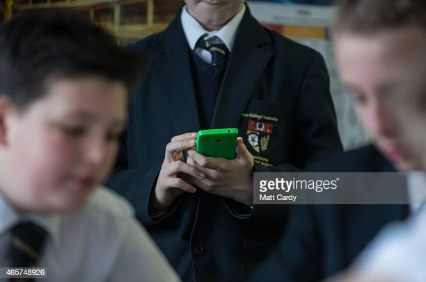 A pupil uses his mobile phone for research during a english lesson at the Ridings Federation Winterbourne International Academy in Winterbourne near...