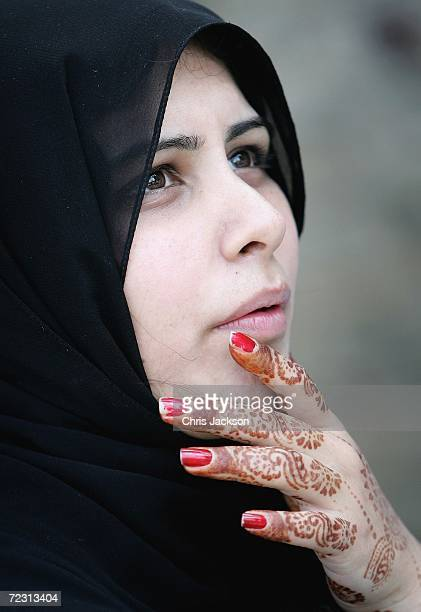 A pupil with henna on her hand looks on at Fatima Jinnah college on the third day of the Royal Tour of Pakistan on October 31 2006 in Islamabad...