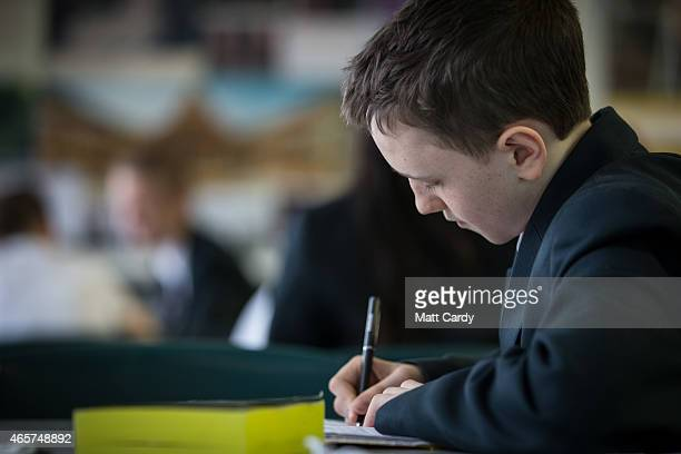 A pupil writes during a english lesson at the Ridings Federation Winterbourne International Academy in Winterbourne near Bristol on February 26 2015...