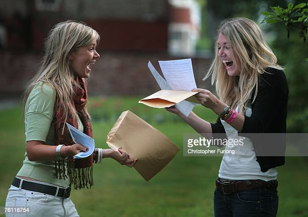 Pupils Alice Wright and Rebecca Pinder both aged 18 of Withington Girls School celebrate after collecting their A level results on August 16...