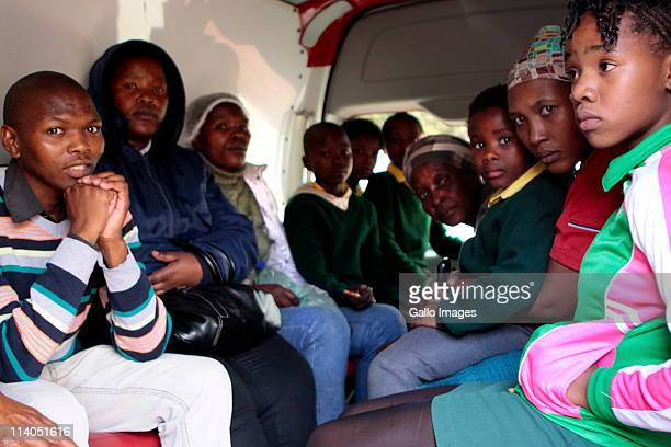 Pupils and their parents sit inside an ambulance at the Trevor Manual Primary School on May 10 2011 in Fisantekraal near Cape Town South Africa Over...