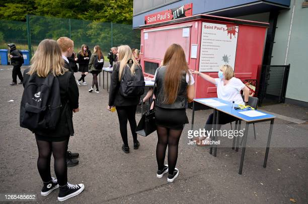 Pupils are given directions as they return to St Paul's High School for the first time since the start of the coronavirus lockdown nearly five months...