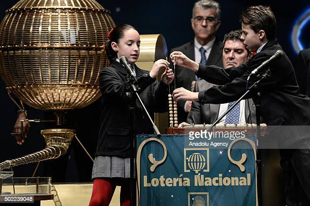 Pupils are seen during the traditional Spanish 'El Gordo' Christmas lottery draw at the Royal Opera House in Madrid Spain 22 December 2015