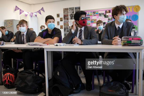 Pupils arrive for their first lessons on their first day back from lockdown at Chertsey High School on March 09, 2021 in Chertsey, United Kingdom....