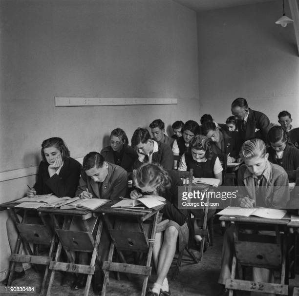 Pupils at a camp school for evacuated co-eds during World War II, UK, October 1940.