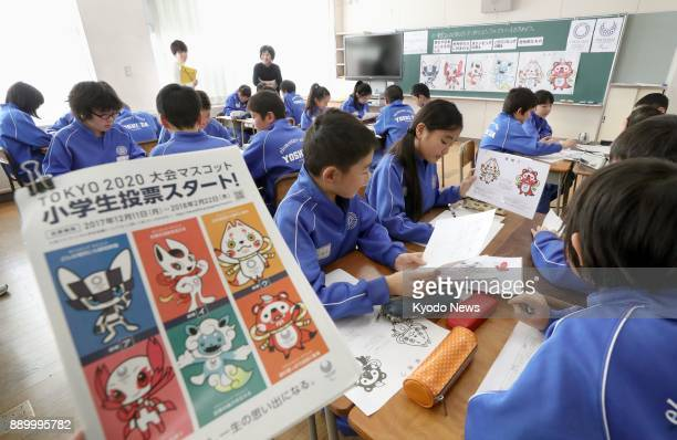 Pupils at an elementary school in Fukushima northeastern Japan engage in discussion on Dec 11 on which of the three pairs of candidate characters...