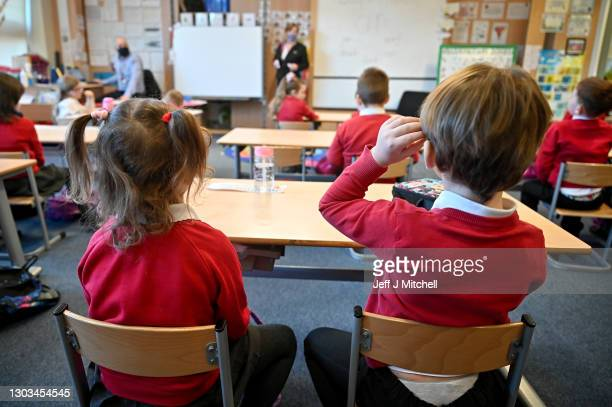 Pupils at Cleeves Primary School return to the classroom on February 22, 2021 in Glasgow, Scotland. The phased return of P1 to P3 pupils to the...