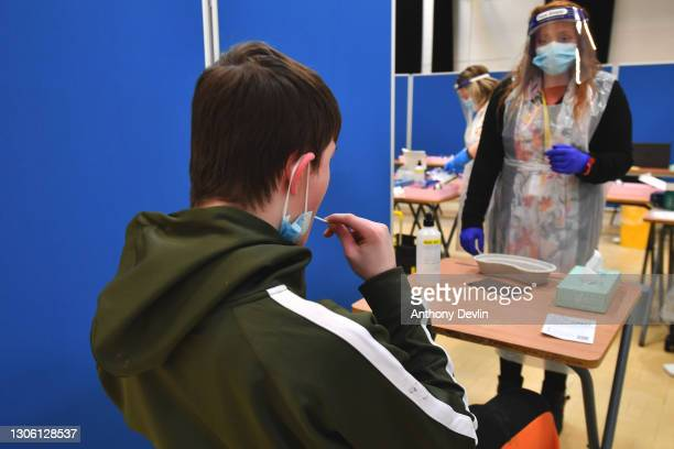 Pupils at Copley Academy take COVID-19 tests in the school hall the day before their year returns to school on March 09, 2021 in Manchester, England....