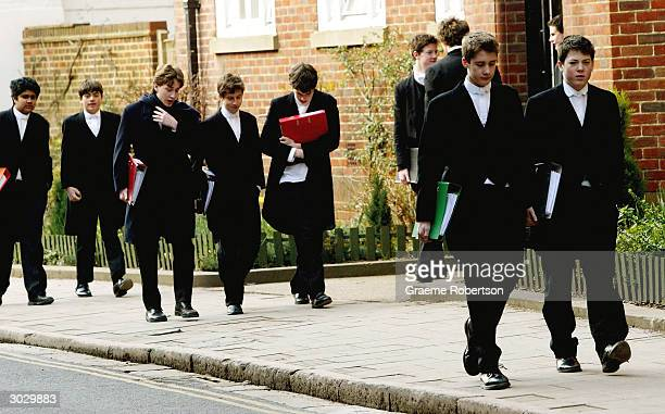Pupils at Eton College hurry between lessons March 1 2004 wearing the school uniform of tailcoats and starched collars in Eton England Dozens of the...