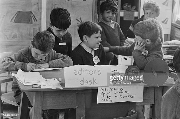 Pupils at John Hampden School working on their own newspaper in the classroom, High Wycombe, Buckinghamshire, 24th May 1967. The editors, Mark Pym...