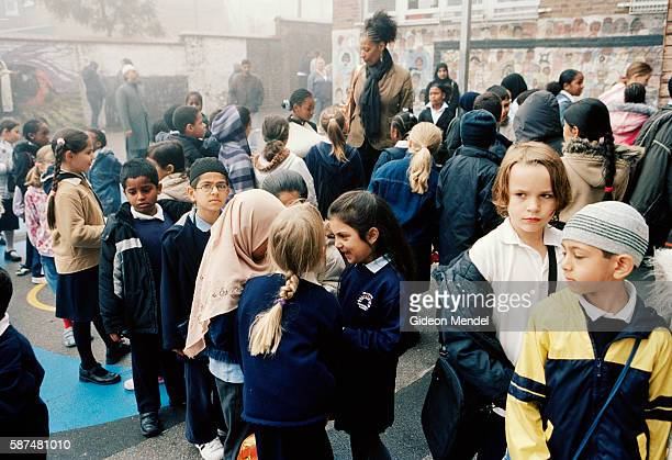 Pupils at Millfields Community School line up in their playground before school in the morning The school is a large innercity primary school with...