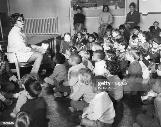 Pupils at Ring Cross Infants School, Highbury, London, during an assembly, with their new headteacher Mrs Yvonne Connolly, who is the first West...