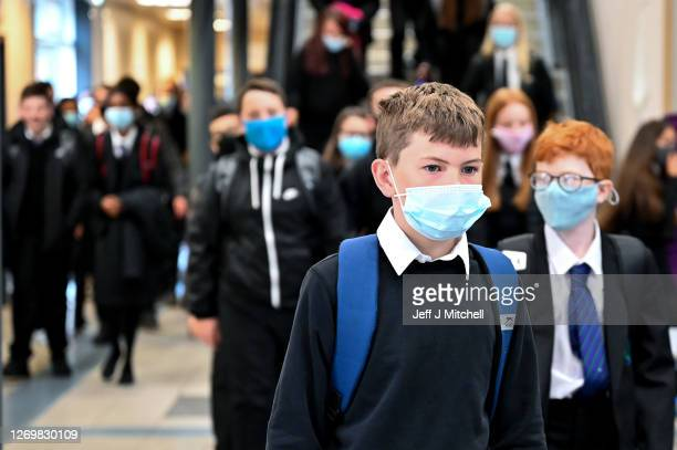 Pupils at Rosshall Academy wear face coverings as it becomes mandatory in corridors and communal areas on August 31, 2020 in Glasgow, Scotland. New...